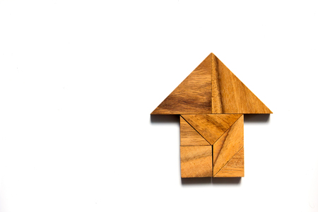 Chinese tangram puzzle in home shape on white background
