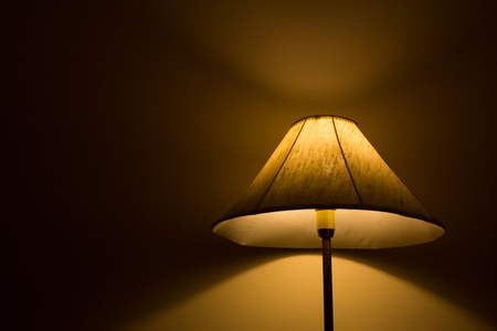 Standing lamp with light and shadow background
