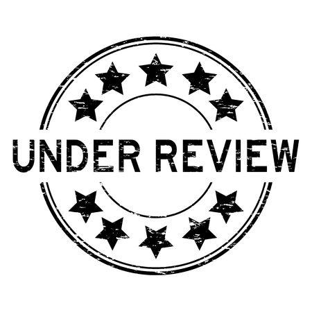 Grunge black under review with star icon round rubber stamp