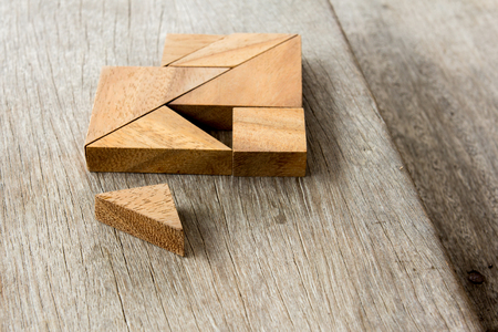 inventive: Tangram puzzle wait for fulfill to heart shape on wooden table