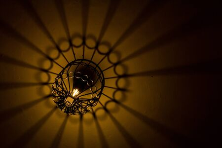 nights: Abstract light and shade come from lightbulb and lantern