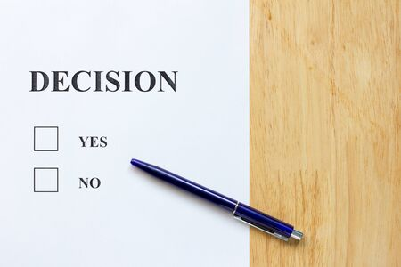 yes no: Decision paper with yes and no choice on wood background