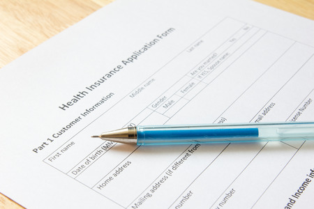 doctor money: Blank health insurance application form with pen wait for fill data