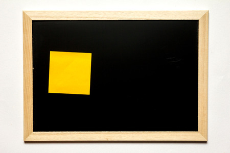 Note paper in black board with wood frame on white background Stock Photo