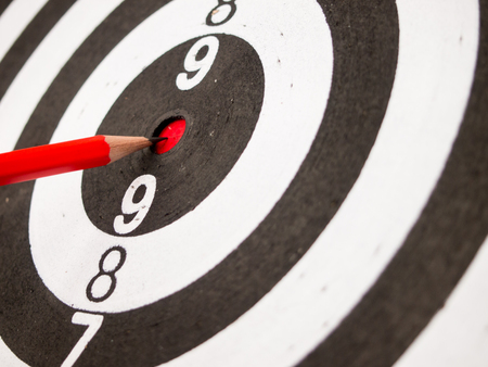 pencil point: Black and white dart with the pencil point at the center (Concept for target, achievement, business focus) Stock Photo