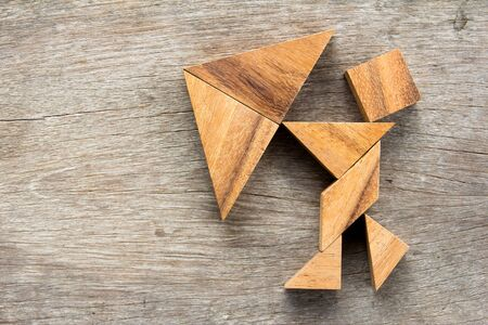 dissection: Tangram puzzle in man hold umbrella (Concept for business about face the crisis or problem) Stock Photo