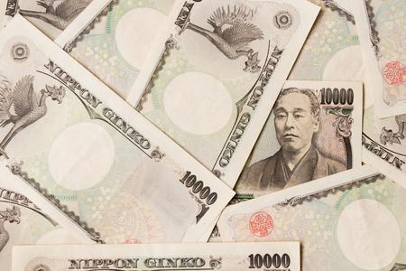 yen note: Group of Japanese bank note 10000 yen background Stock Photo
