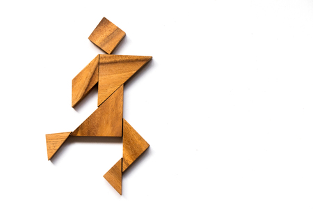 Wooden tangram as happy man shape on white background (Concept as business has success)