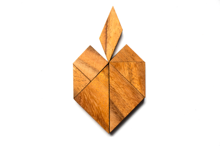 Wooden tangram puzzle in apple shape on white background
