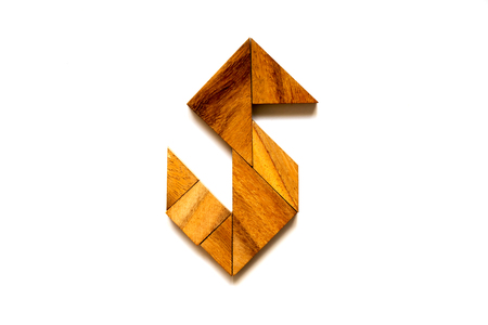 Wooden tangram puzzle as English alphabet letter S shape on white background