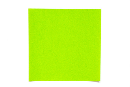 Green color paper sheet on white background used for decoration or design element