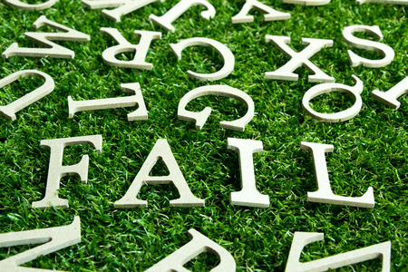 Wording fail on artificial green grass with another english alphabet background Stock Photo