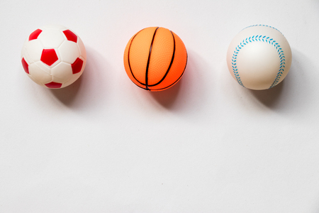 Group of football, baseball and basketball placed on white background
