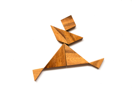 Wooden tangram puzzle in dancing man shape on white background Archivio Fotografico
