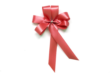 Red bow as award ribbon on white background