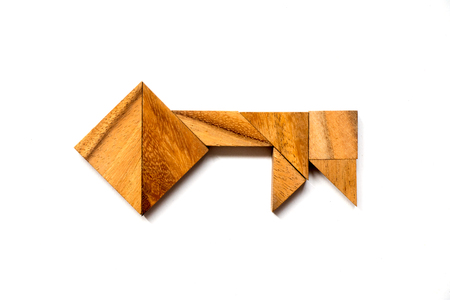Wooden tangram puzzle in key shape on white background (Concept of data security, authurized access, safety)