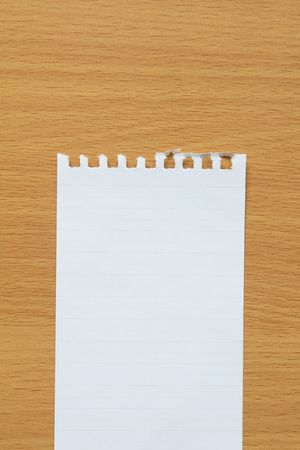 Blank lined paper on wood table for writing, remind for to do list