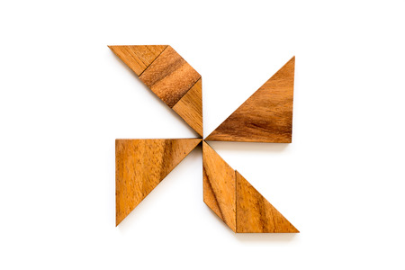 Wood tangram puzzle in turbine shape on white background