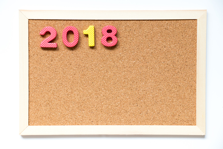 Cork board with number as 2018 wording on white background