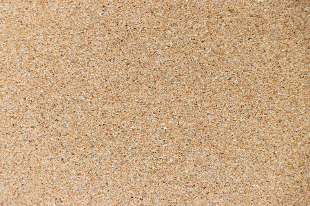 Brown yellow color of cork board textured background