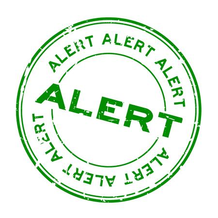 Grunge green alert round rubber seal stamp on white background