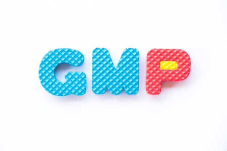Color toy foam alphabet in word GMP (Abbreviation of Good Manufacturing Practice) on white background