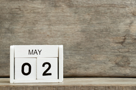 White block calendar present date 2 and month May on wood background Archivio Fotografico