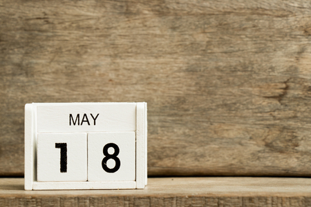 White block calendar present date 18 and month May on wood background Stock Photo