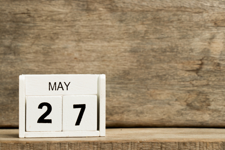 White block calendar present date 27 and month May on wood background Stock Photo