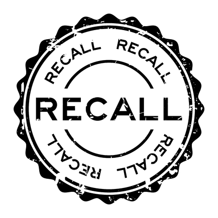 Grunge black recall word round rubber seal stamp on white background