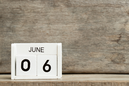 White block calendar present date 6 and month June on wood background Stock Photo