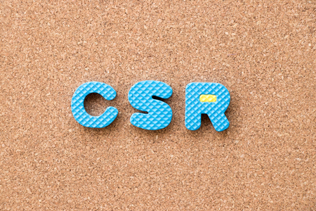 Color toy foam alphabet in word CSR (Abbreviation of corporate social responsibility) on cork board background