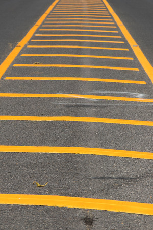 Yellow color road line on asphalt background