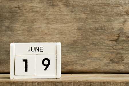 White block calendar present date 19 and month June on wood background Stock Photo