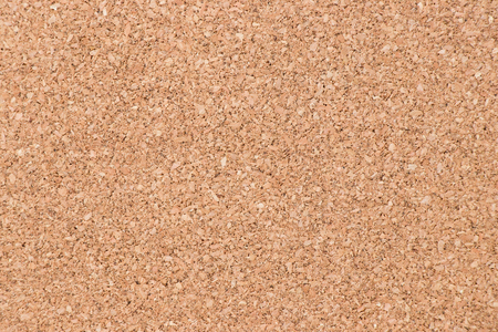 Closed up of brown color cork board textured background Foto de archivo