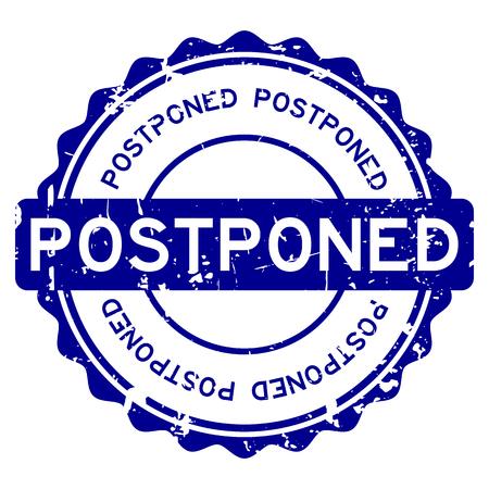 Grunge blue postponed word round rubber seal stamp on white background
