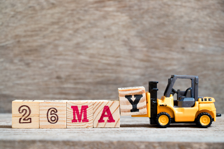 Toy forklift hold block Y to complete word 26 may on wood background (Concept for calendar date for month May) Stock Photo