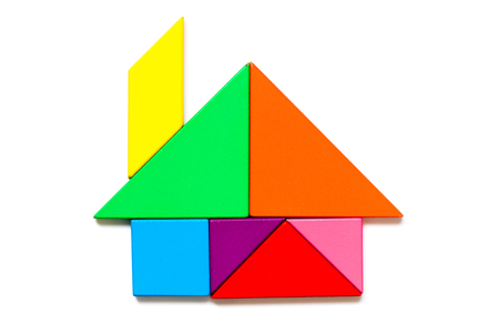 Color wood tangram puzzle in home shape on white background