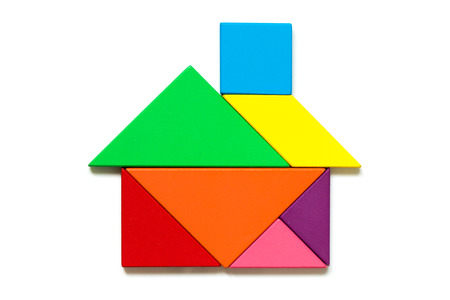 Color wood tangram puzzle in home shape on white background 写真素材 - 100927688