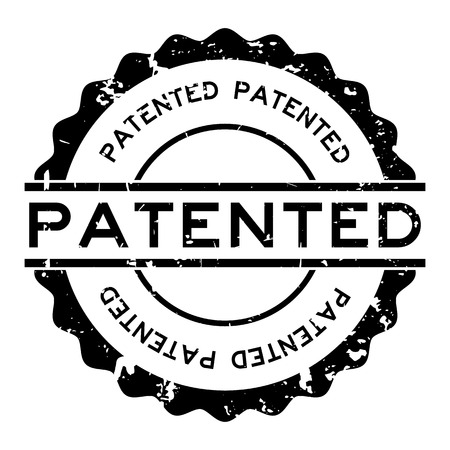 Grunge black patented word round rubber seal stamp on white background