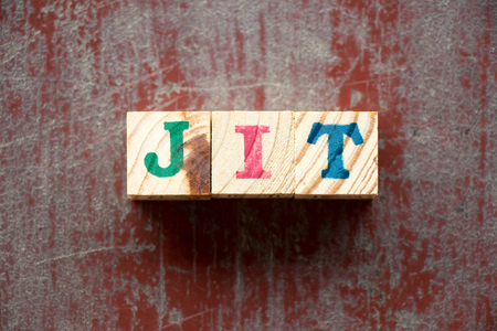 Letter block in word JIT (Abbreviation of just in time) on old red wood background