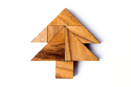 Wood tangram puzzle in tree shape on white background Stock Photo
