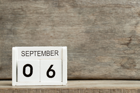 White block calendar present date 6 and month September on wood background Stock Photo