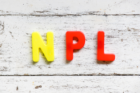 Color alphabet in word NPL (Abbbreviation of Non Performing Loan, Non-Patent Literature) on grunge old white wood background Stock Photo