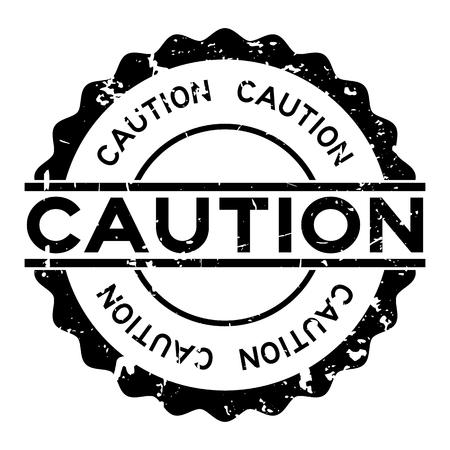 Grunge black caution word round rubber seal stamp on white background