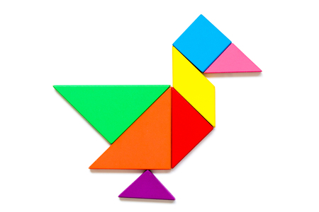 Color wood tangram puzzle in duck shape on white background