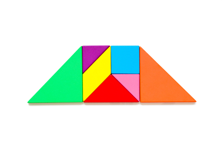Color wood tangram puzzle in trapezoid shape on white background 写真素材