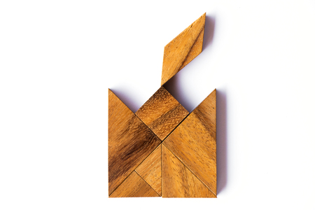 Wood tangram puzzle in candle shape on white background