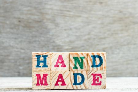 Letter block in word handmade on wood background Banco de Imagens