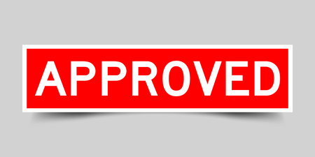 Red sticker with word approved on gray background